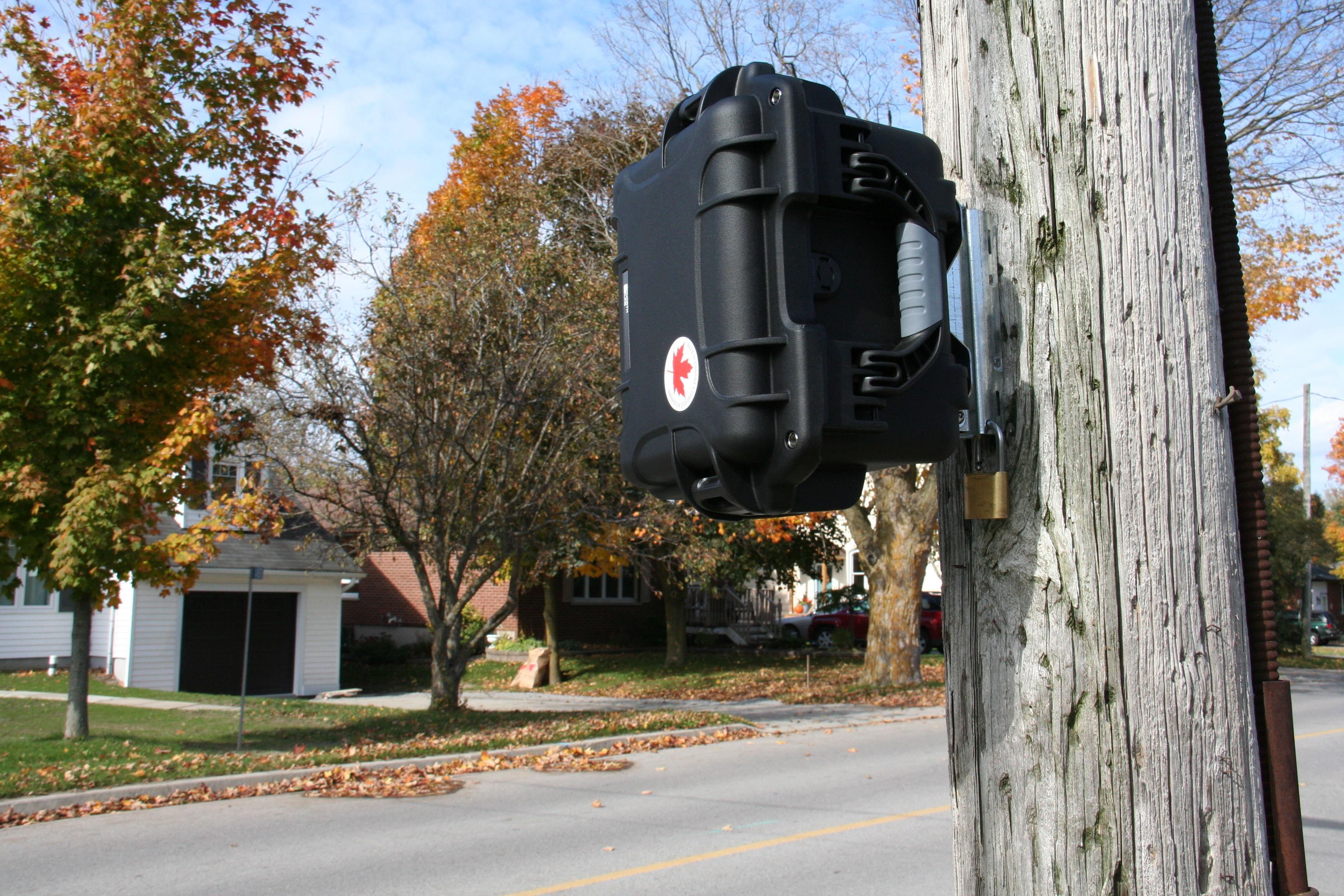 Black CAT radar secured and locked to utility pole on Old Simcoe Rd., Port Perry, Ontario